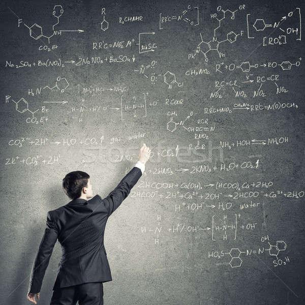 Scientist writing formulas on chalkboard Stock photo © adam121