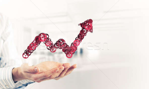 Progressing graph presented in male palms as symbol of success a Stock photo © adam121