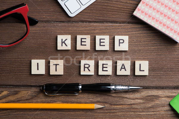 Motivation conceptual phrase collected of wooden blocks on business workplace Stock photo © adam121