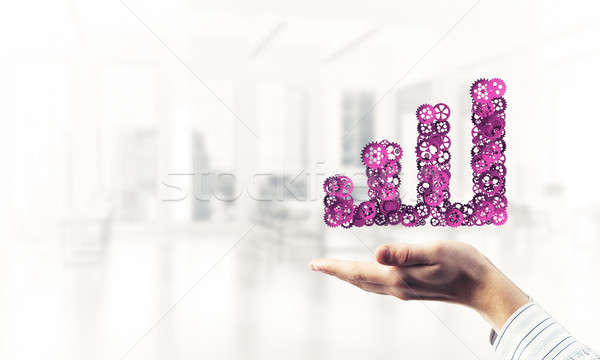 Stock photo: Progressing graph presented in male palms as symbol of success a