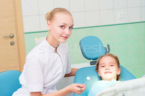 young doctor woman and girl in dentist office Stock photo © adam121