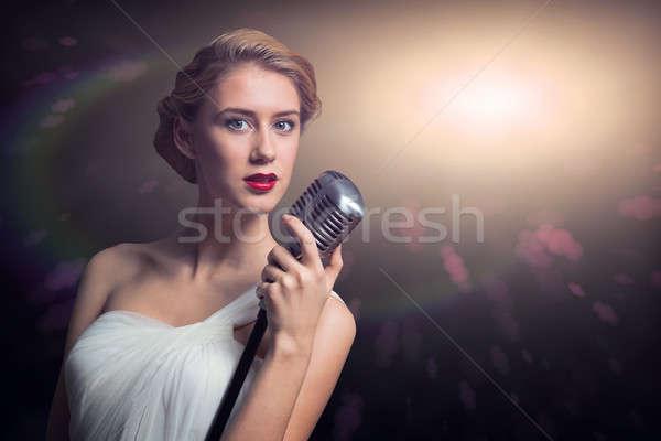 Atrakcyjna kobieta piosenkarka mikrofon za streszczenie moda Zdjęcia stock © adam121