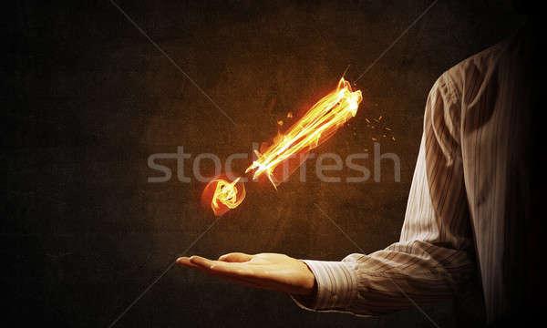 Ognia wykrzyknik symbol dłoni ciemne Zdjęcia stock © adam121