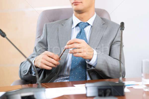 üzletember ül asztal tart toll üzlet Stock fotó © adam121