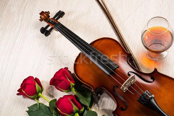 Violino rosa vetro champagne musica libri Foto d'archivio © adam121