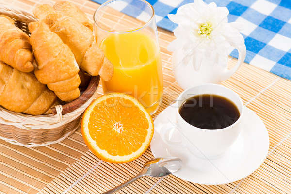 Colazione continentale caffè fragola cornetto succo frutta Foto d'archivio © adam121