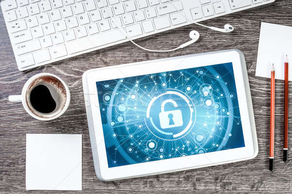 Business workplace with tablet pc and security concept on screen Stock photo © adam121