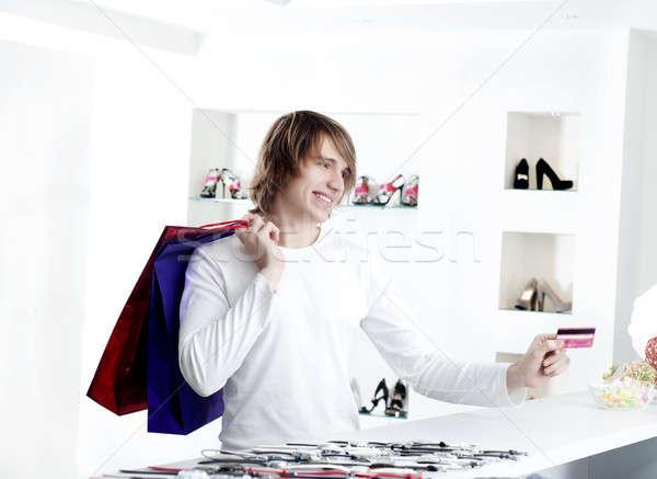 Férfi vásárlás pénztár fizet hitelkártya fiatalember Stock fotó © adam121