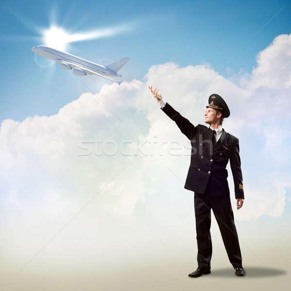 Pilot form el uçak uçan bulutlar Stok fotoğraf © adam121