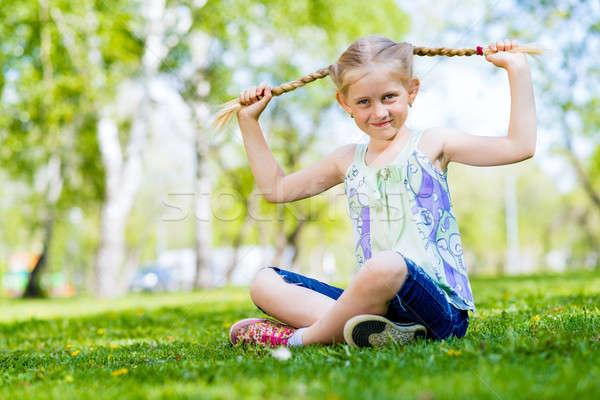 肖像 少女 公園 座って 草 笑顔 ストックフォト © adam121