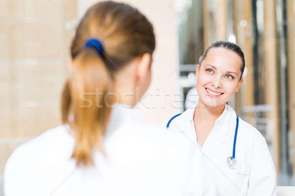 Kettő orvosok beszél lobbi kórház ül Stock fotó © adam121