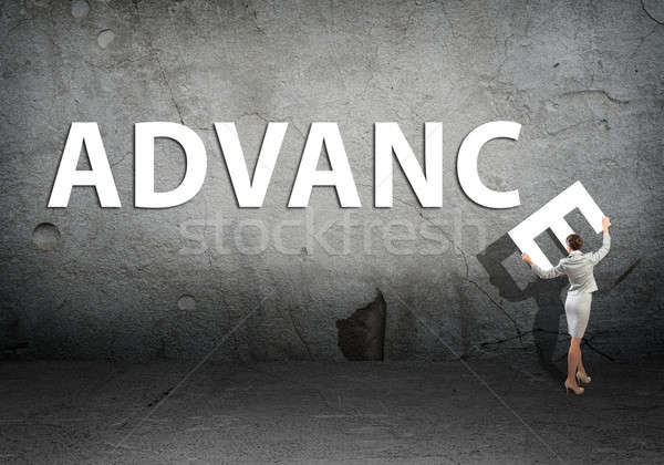 young businesswoman adds advance word Stock photo © adam121