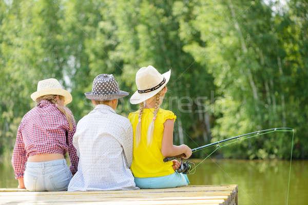 лет рыбалки вид сзади три детей сидят Сток-фото © adam121