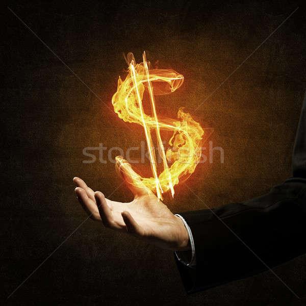 Dollaro valuta fuoco simbolo vicino imprenditore Foto d'archivio © adam121