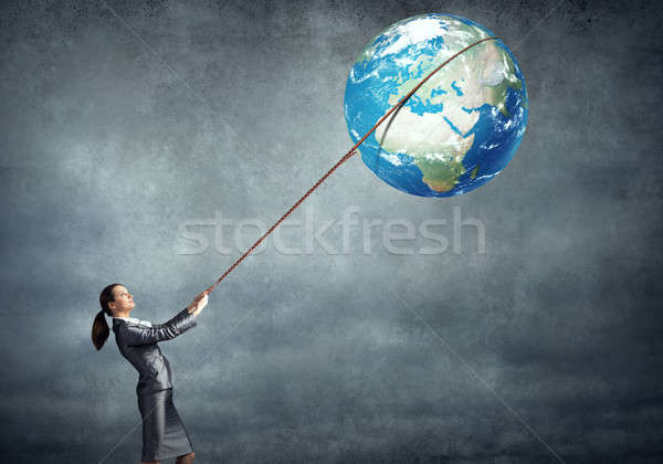 Woman catch Earth planet Stock photo © adam121