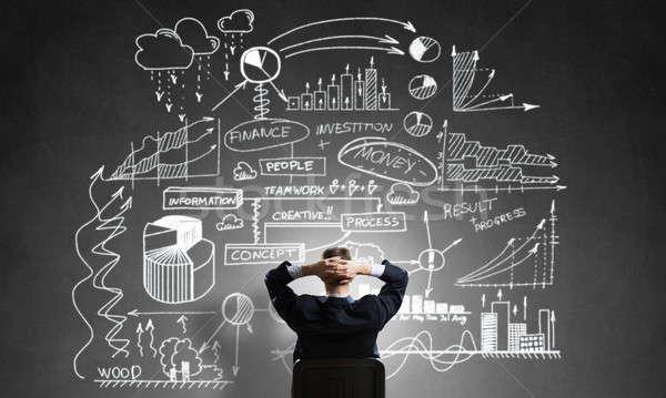 ストックフォト: ビジネスマン · 図面 · ビジネス戦略 · 背面図 · 座って · 事務椅子