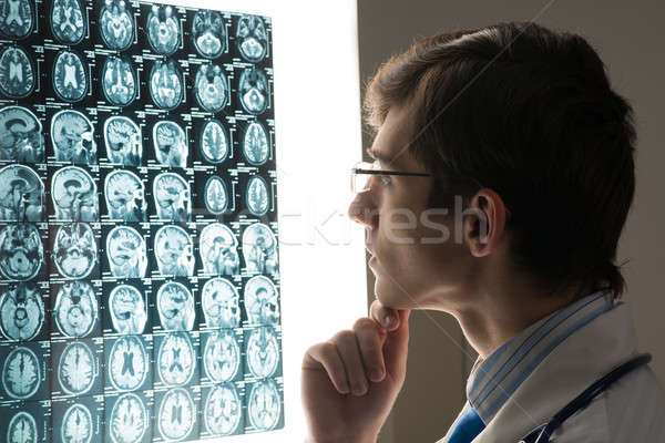 male doctor looking at the x-ray image Stock photo © adam121