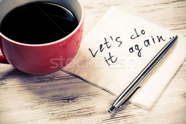 Stock photo: Let us do it again written on napkin