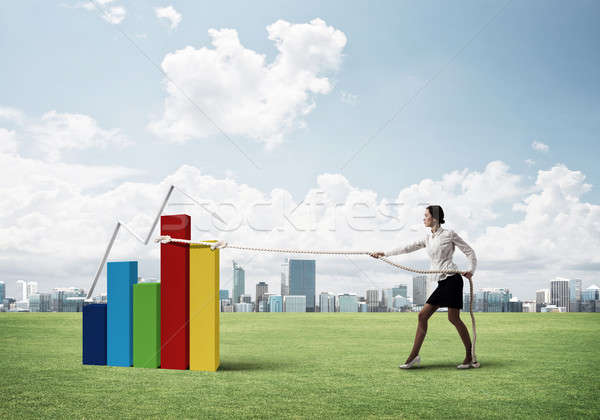 Businesswoman pulling arrow with rope and making it raise up Stock photo © adam121