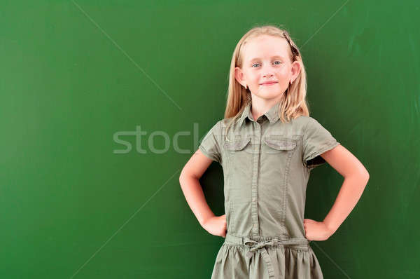 schoolgirl portrait near the blackboards Stock photo © adam121