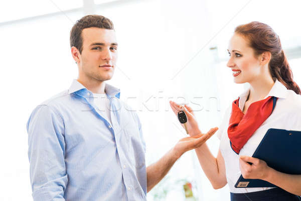 Stock photo: Consultant in the showroom and the buyer