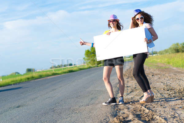 Two young women stand with a blank banner Stock photo © adam121