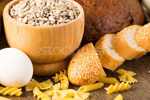 Stock photo: Fresh bread, eggs, pasta and grains