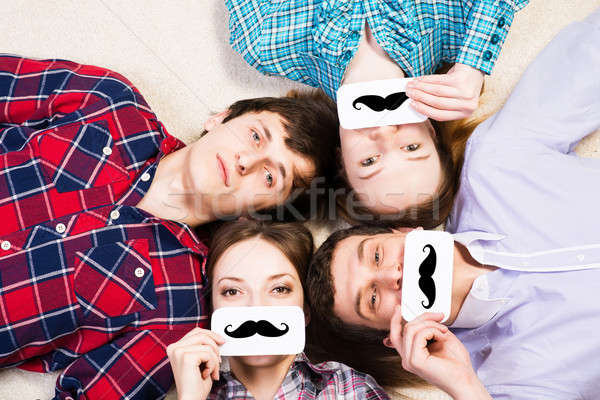 four young men lie together Stock photo © adam121