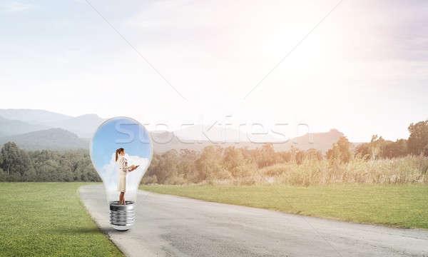 Businesswoman inside light bulb Stock photo © adam121