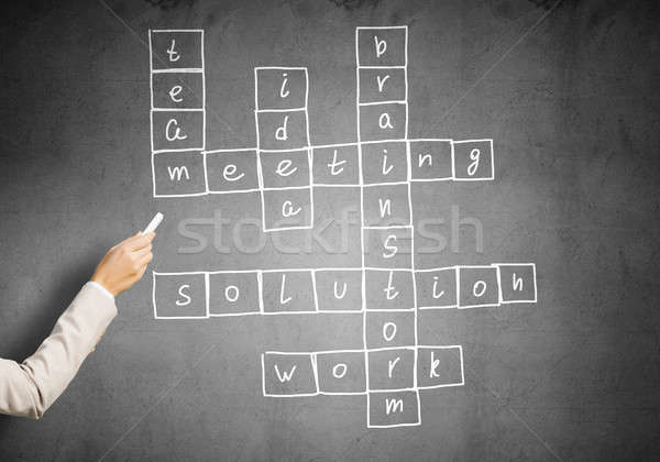 Mulher desenhar palavras cruzadas negócio lousa Foto stock © adam121