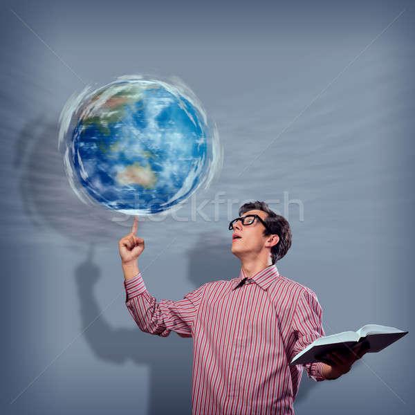 молодым человеком книга пальца символ планете Земля Сток-фото © adam121