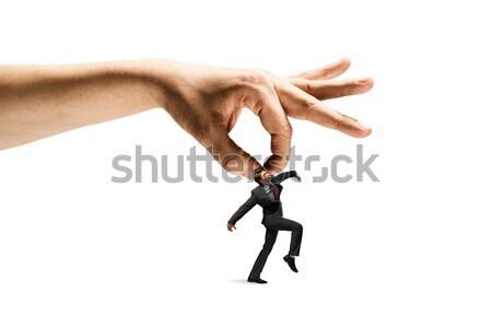 Hand catching man Stock photo © adam121