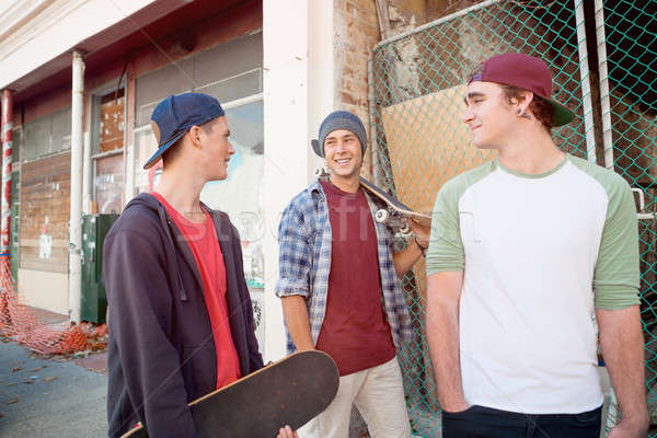 Stock photo: Guys skateboarders in street