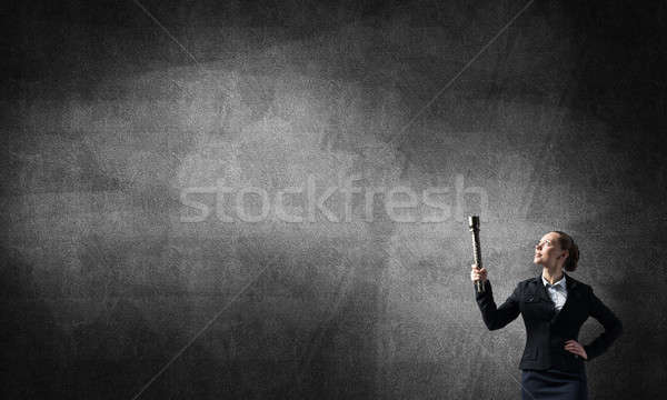 Woman with flashlight in hand Stock photo © adam121