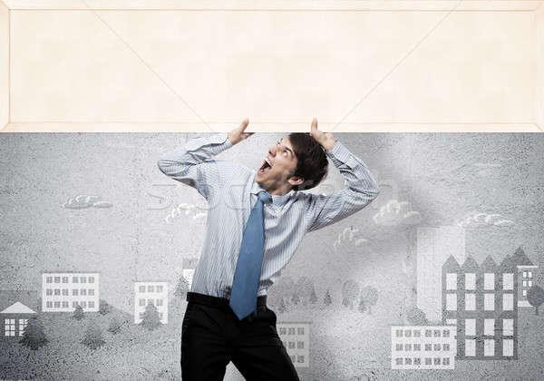Businessman with blank banner Stock photo © adam121