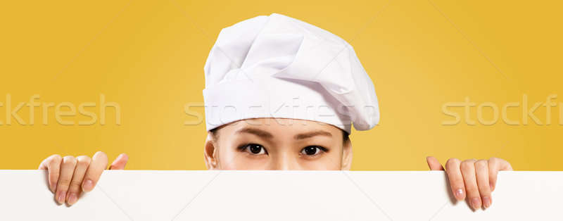 Asian female chef holding poster for the text Stock photo © adam121