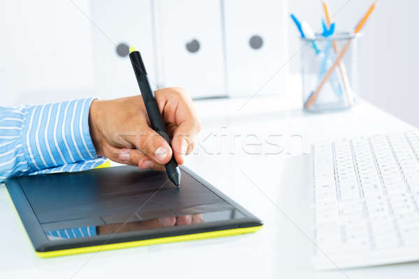 close-up of a man's hand with a pen stylus Stock photo © adam121