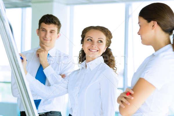 Empresários reunião flipchart negócio consultor discutir Foto stock © adam121