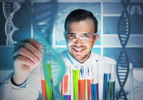 Young scientist mixing reagents in glass flask in clinical laboratory Stock photo © adam121