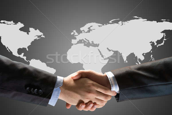 Two businessmen shaking hands Stock photo © adam121