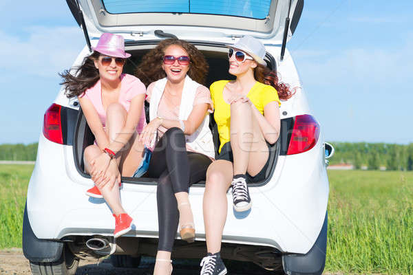 young attractive woman sitting in the open trunk Stock photo © adam121