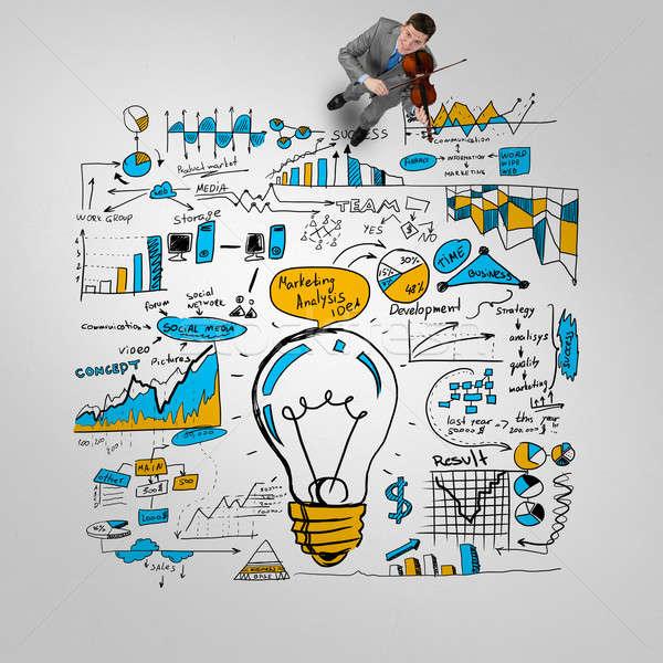 Businessman play success melody Stock photo © adam121