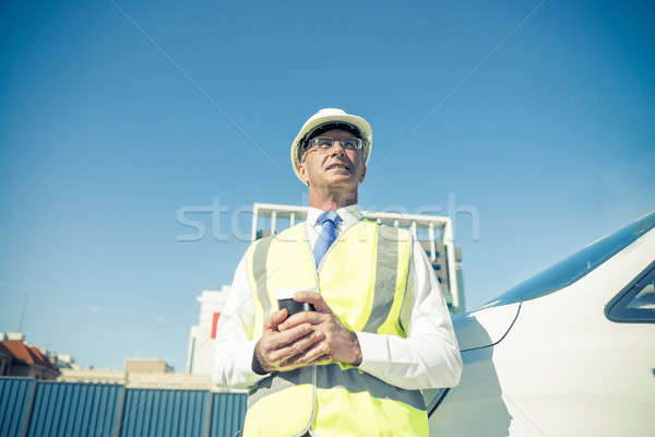 Engineer builder on construction site at sunny day with coffee i Stock photo © adam121