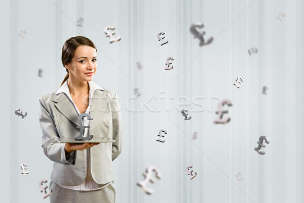 business woman holding a tablet with british pound Stock photo © adam121