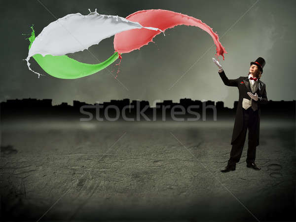 magician and splashes of color paint Stock photo © adam121