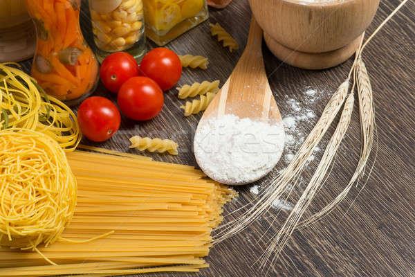 Pasta pomodori farina cucchiaio ancora vita foglia Foto d'archivio © adam121