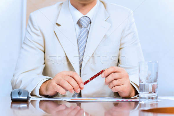 businessman holding a pen in hand Stock photo © adam121