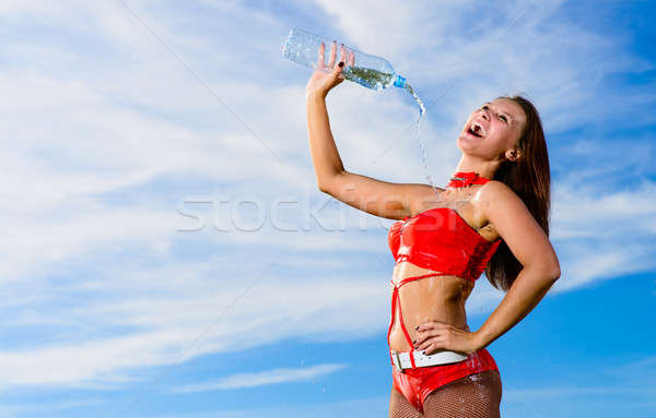 sport girl in red uniform with a bottle of water Stock photo © adam121