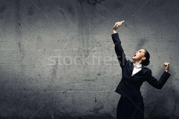 агрессивный управления молодые деловая женщина кричали мобильного телефона Сток-фото © adam121
