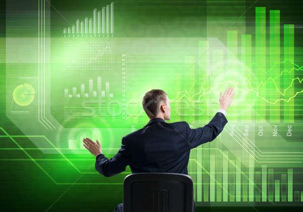Businessman using media interface Stock photo © adam121